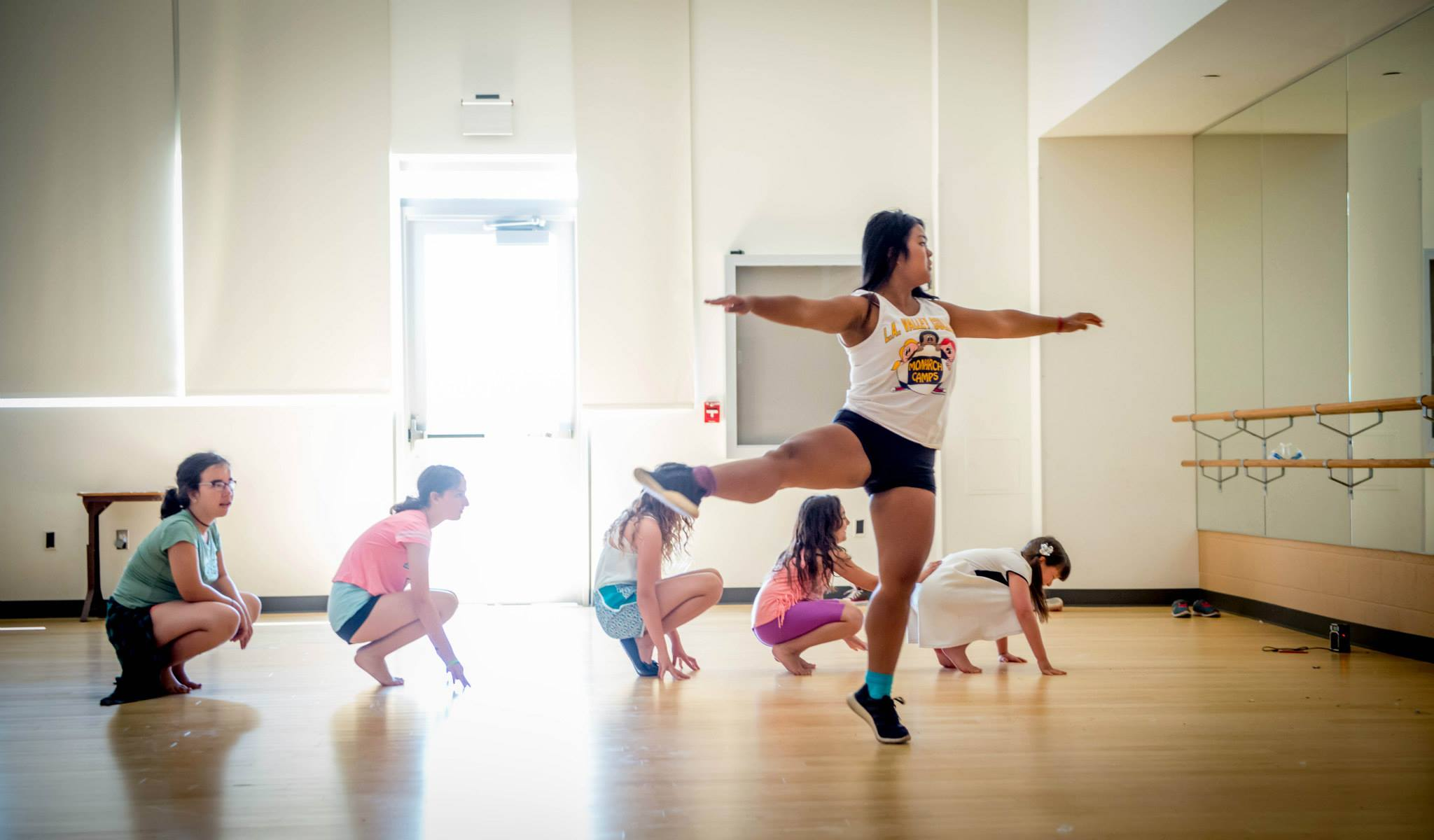 https://monarchcamps.com/wp-content/uploads/2018/01/dance-camp-for-children-in-los-angeles-summer-day-camp-children-dancing-in-dance-studio.jpg