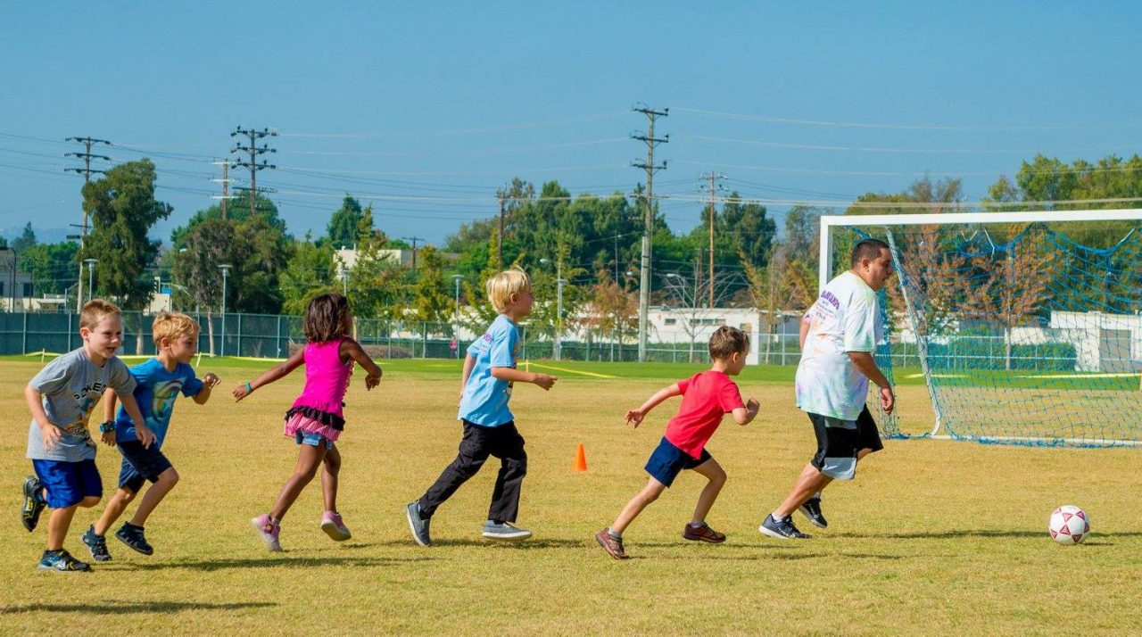 monarch-camps-summer-camp-los-angeles-soccer-camp-children-chasing-soccer-ball-on-soccer-field-1280x714.jpg