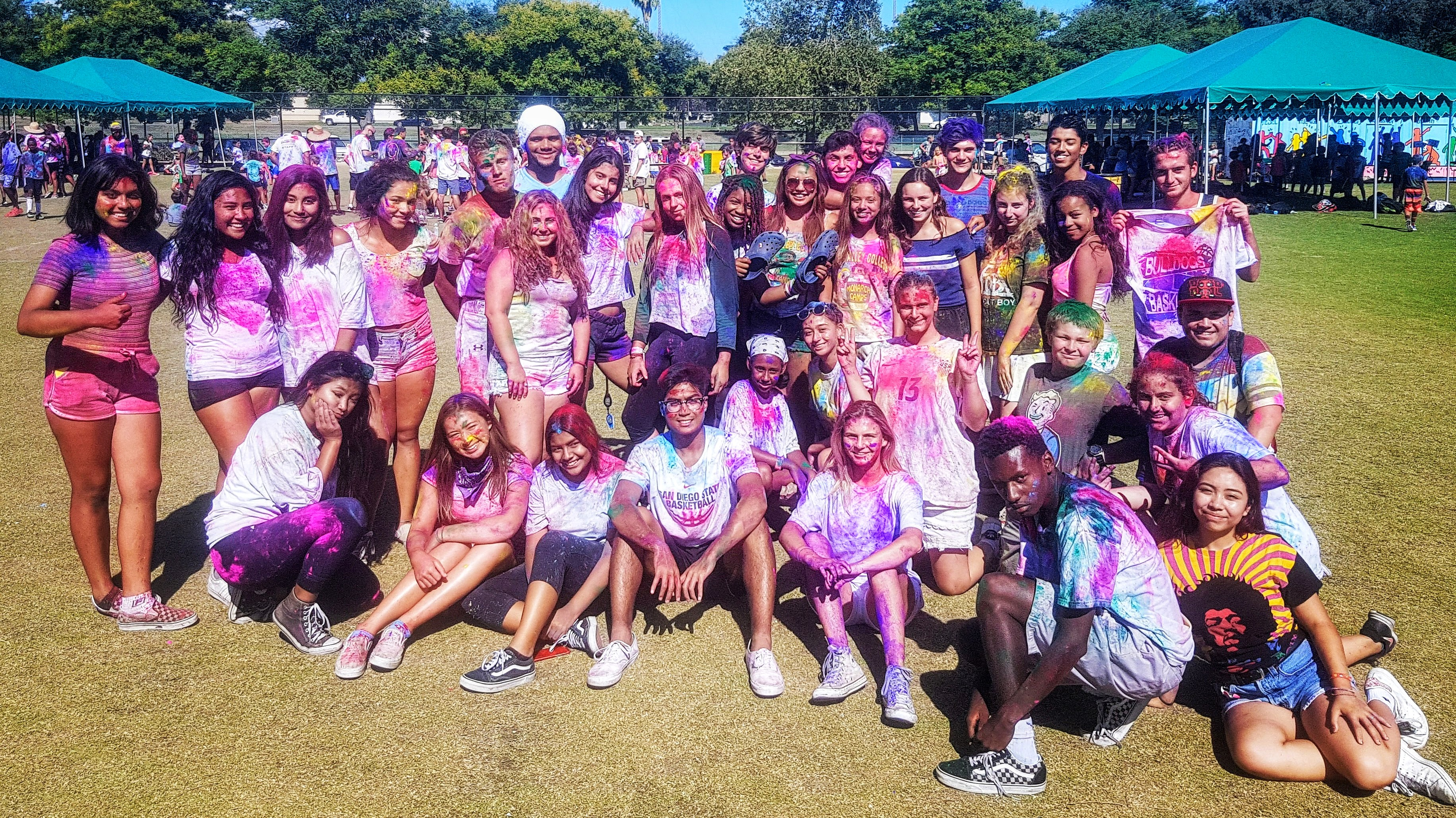 https://monarchcamps.com/wp-content/uploads/2018/01/monarch-camps-summer-camp-los-angeles-teenagers-smiling-after-color-paint-party.jpg