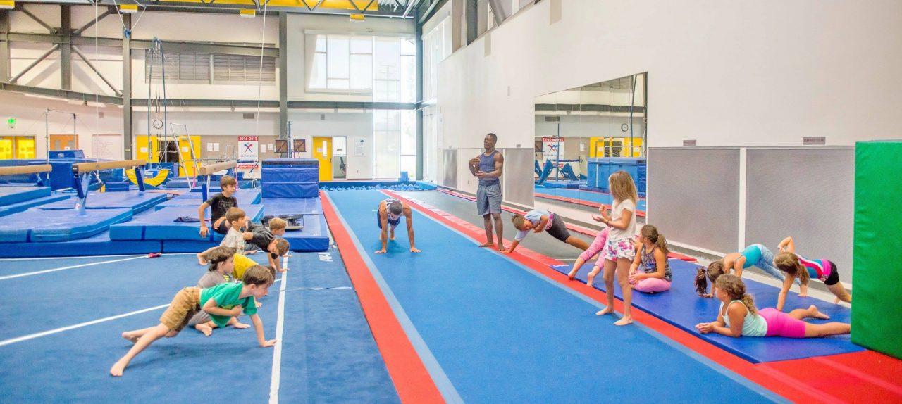monarch-camps-summer-children-gymnastics-day-camp-in-los-angeles-children-stretching-on-trampoline-1280x574.jpg
