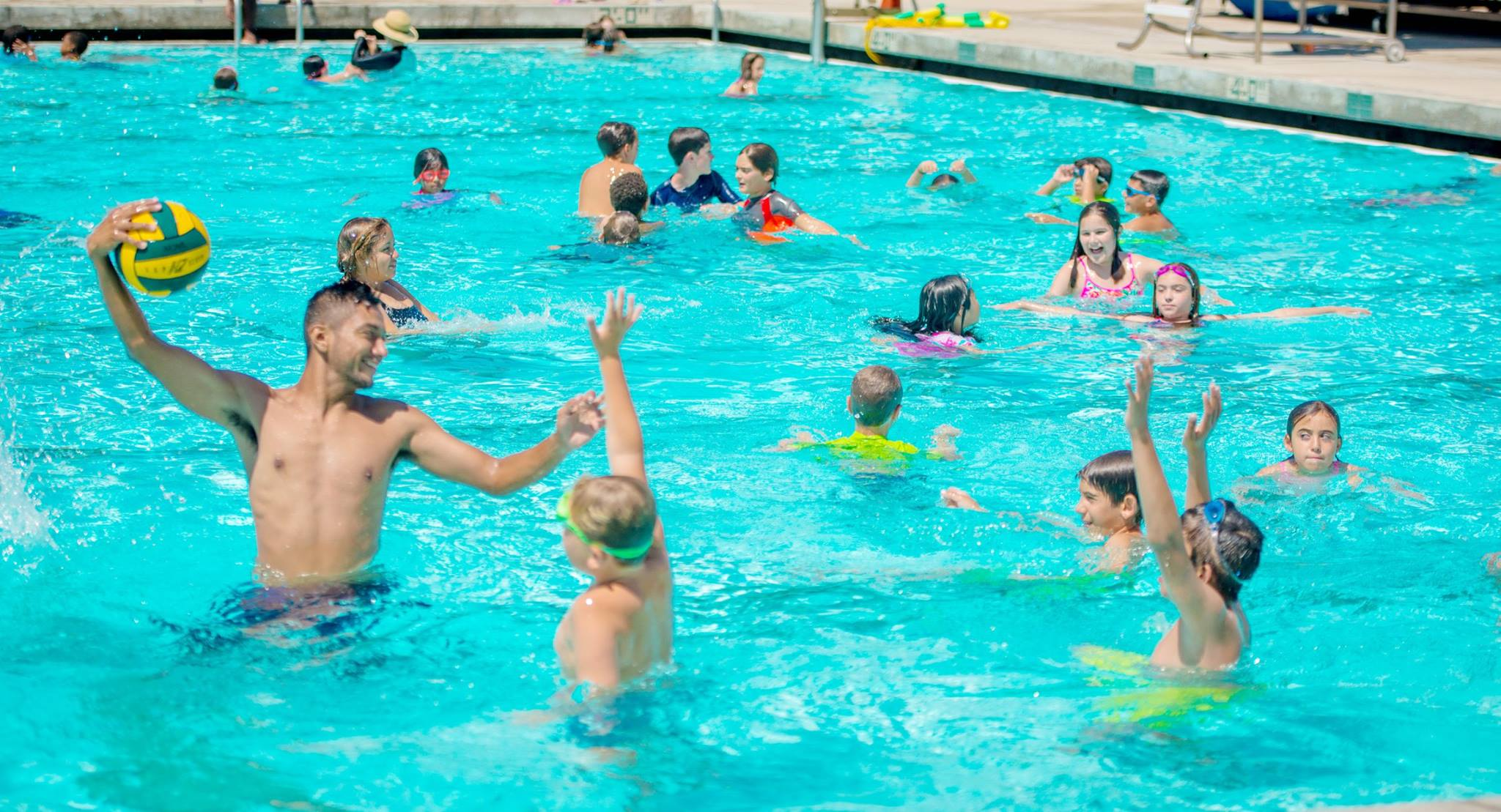 https://monarchcamps.com/wp-content/uploads/2018/01/summer-camp-in-los-angeles-swimming-pool-at-los-angeles-valley-college-children-playing-water-polo.jpg