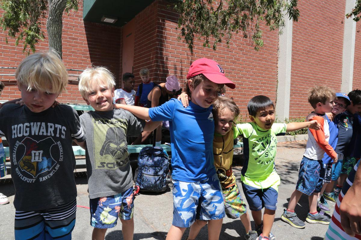 https://monarchcamps.com/wp-content/uploads/2018/01/summer-day-camp-los-angeles-friends-hugging-1.jpg